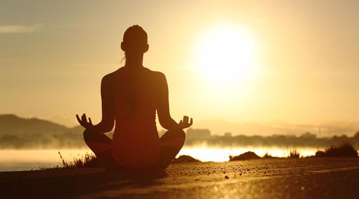 Doing Yoga infront of Sunrise