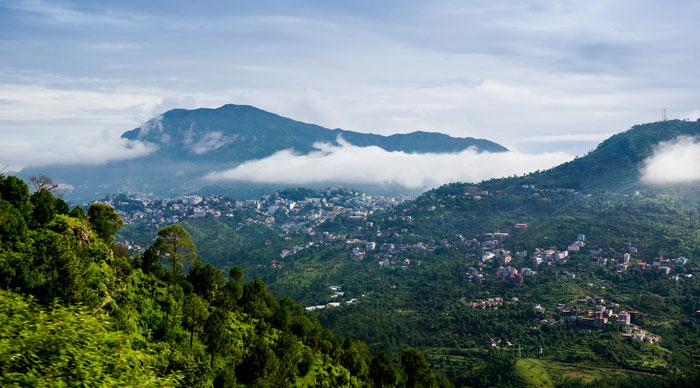 Clouds rolling between the hills of himachal pradesh