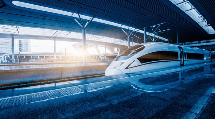Speeding train away from railway station, Shanghai China