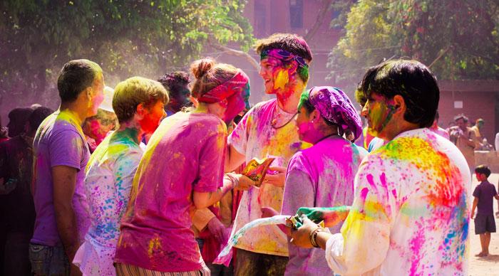 Tourist with students celebrating festival Holi