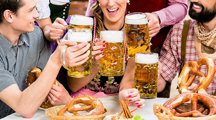 People enjoying beers in the Oktoberfest Germany