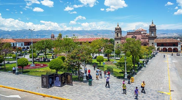 People passing through the Plaza de Armas in Ayacucho Peru