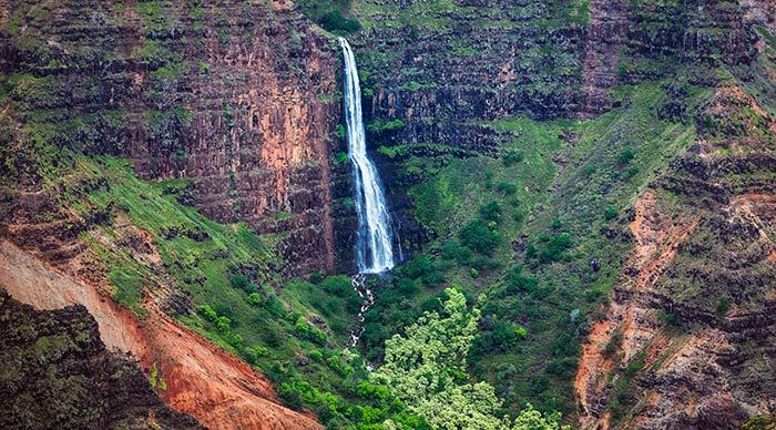 Landscape view of Waipoo waterfall in Waimea canyon Kauai Hawaii USA
