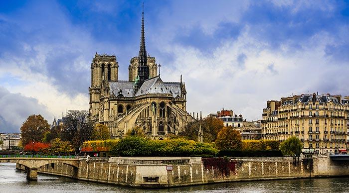 Picturesque cityscape of Seine and Cathedral of Notre Dame de Paris at autumn