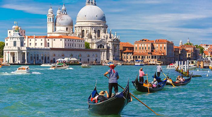 Picturesque view of Gondolas on Canal Grande with Basilica di Santa Maria della Salute in the background, Venice, Italy