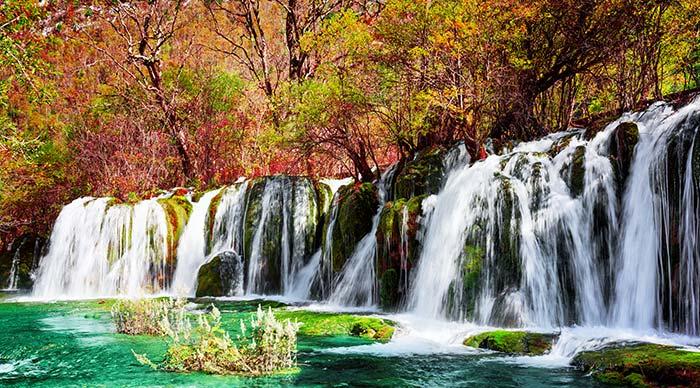 Beautiful waterfall and Azure lake in Jiuzhaigou nature reserve