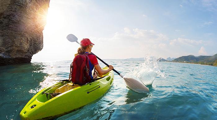 Young lady paddling the kayak in Santa Cruz Island