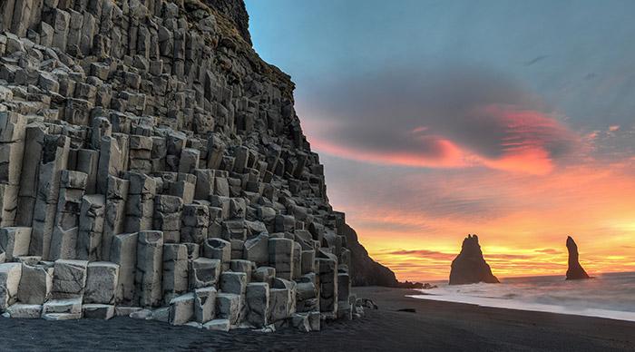 Reynisdrangar rock formations on Reynisfjara Beach at sunrise Halsanefhellir Iceland